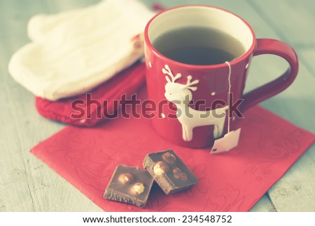 Retro photo of cute coffee cup with chocolate - stock photo