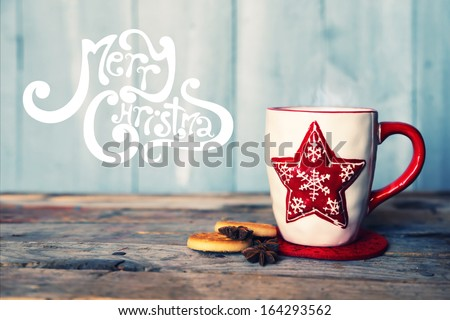 Retro photo of cute coffee mug with cookies - stock photo