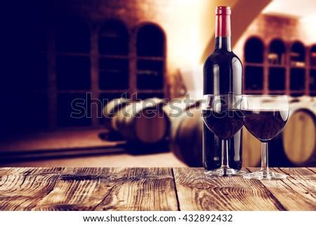 retro photo of few barrels and glasses of wine  - stock photo