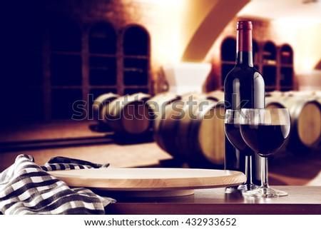 retro photo of few barrels and wine dark top and napkin and kitchen board  - stock photo