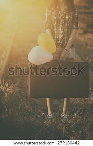 Retro photo of traveler woman - stock photo