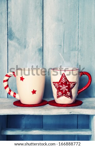 Retro photo of two cute coffee cups - stock photo
