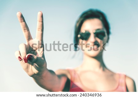 Retro Photo Of Young Girl With Victory Sign - stock photo