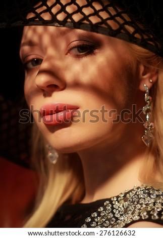 Retro portrait of a beautiful woman. Vintage style. Perfect make-up. Fashion photo - stock photo