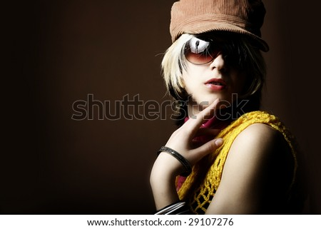 Retro portrait of a girl with sunglasses - stock photo