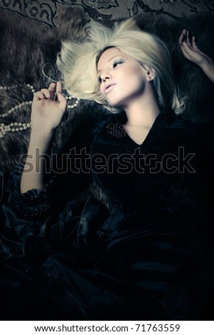 Retro portrait of pretty young blond woman - stock photo