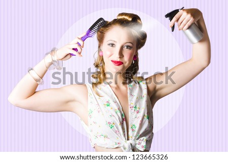 Retro Portrait Of The Classic 50s Pinup Girl With Perfect Make-Up Combing Hairstyle In A Beauty And Fashion Concept - stock photo
