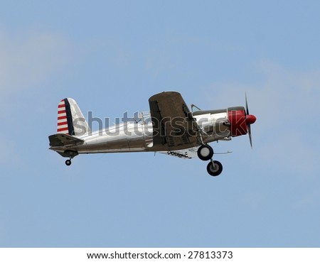 Retro propeller airplane in flight
