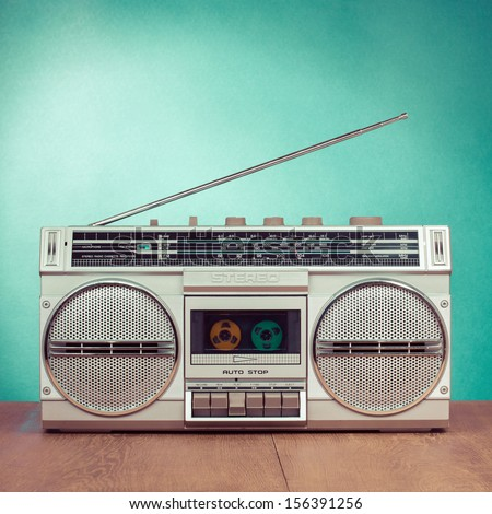 Retro radio and cassette stereo recorder on mint green background - stock photo