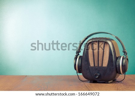 Retro radio and headphones conceptual photo - stock photo