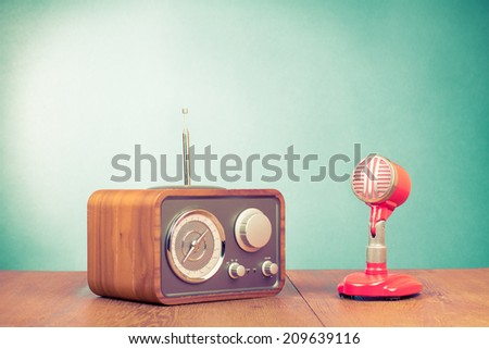 Retro radio and red microphone on table old style photo - stock photo