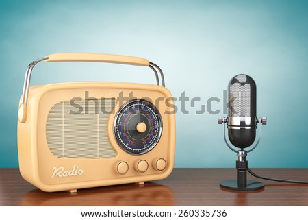 Retro Radio and Vintage Microphone on the table - stock photo