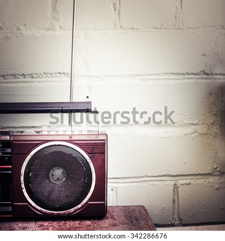 Retro radio cassette stereo recorder on wooden desk - stock photo