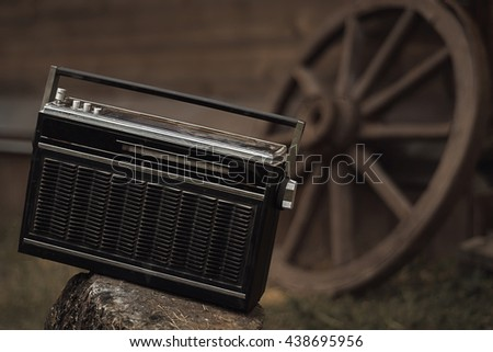 Retro radio receiver background on the wheels of carts