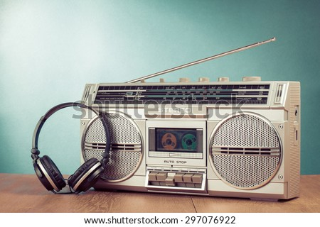 Retro radio recorder from 80s and headphones. Vintage old style instagram filtered photo - stock photo