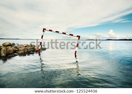 Retro red and white goal in water - stock photo