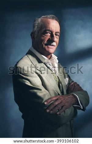 Retro 1940 senior business man. Little smile. Studio shot. - stock photo