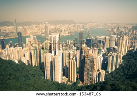 Retro shot of Hong Kong from Victoria Peak. - stock photo