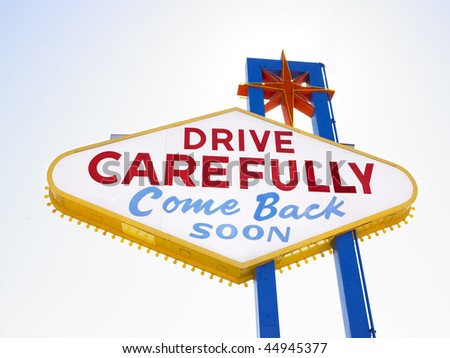 Retro sign saying drive carefully when leaving Las Vegas.  Horizontal shot. - stock photo