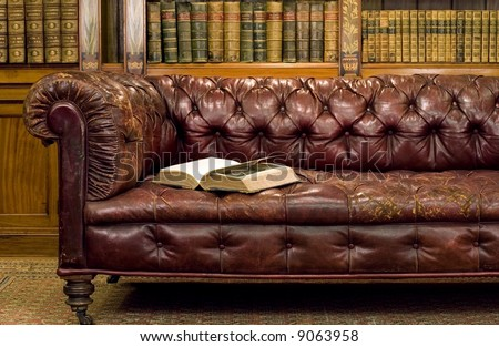 Retro sitting room with leather couch with book on it - stock photo