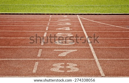 Retro sport running track with number - stock photo