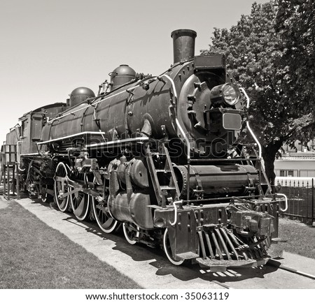 Retro steam engine resting on the tracks