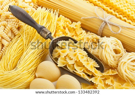 retro still life with assortment of uncooked pasta - stock photo