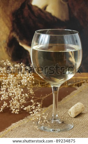 Retro still life with white wine and old painting - stock photo