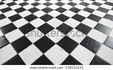 Retro stone floor tiling with black and white checkered pattern