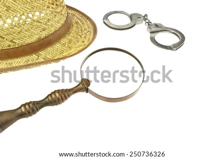 Retro Straw Hat, Magnifying Glass and Handcuffs  Isolated on White Background - stock photo