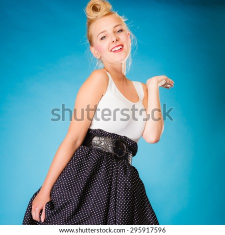 Retro style and dance pose. Blonde pin up girl dancer on blue in studio. - stock photo