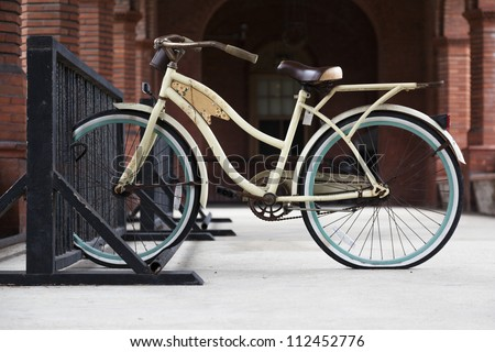 Retro style bicycle parked at bike rack.  St. Augustine, FL, USA. - stock photo