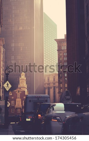 Retro Style Busy Downtown Traffic And Tall Skyscrapers In Boston USA - stock photo