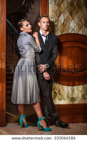 Retro style couple at the door - stock photo