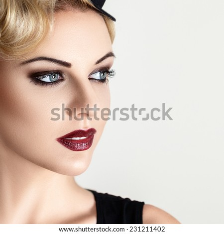 Retro style fashion woman with smoky make-up and vintage hat - stock photo