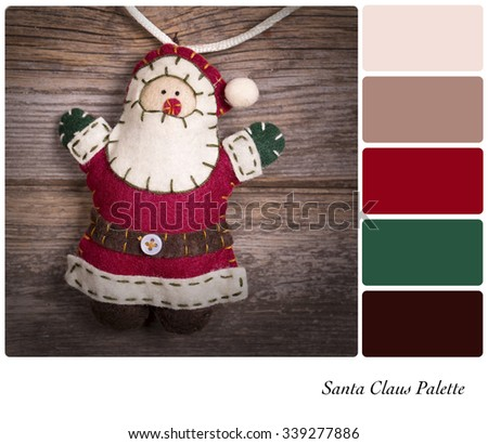 Retro style felt Santa Claus over old wood background. In a colour palette with complimentary colour swatches. - stock photo