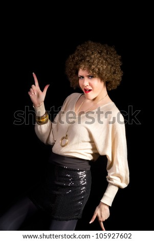 Retro style female disco dancer having fun, shot on black background - stock photo