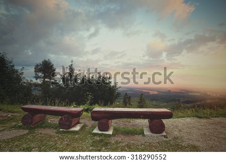 Retro style image of bench at the mountains