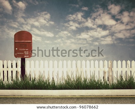 retro style picture of postbox at roadside - stock photo
