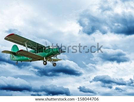 Retro style picture of the biplane.  - stock photo