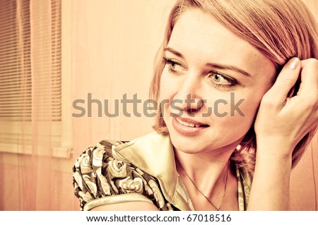 Retro style Portrait of a fresh and lovely woman looking side and fingers her hair - stock photo