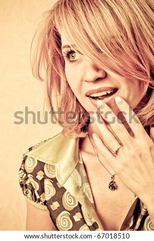 Retro style Portrait of a surprised fresh and lovely woman - stock photo