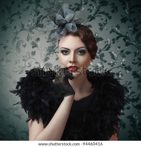 Retro style portrait of young sexy girl touching lips against vintage wallpaper - stock photo
