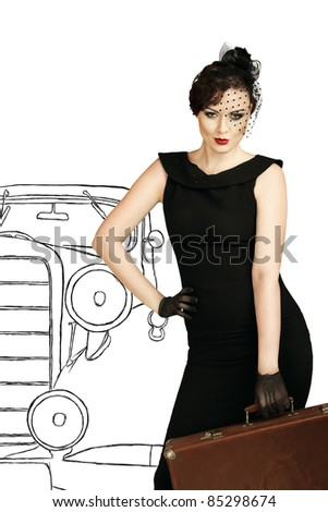 Retro style portrait of young woman with vintage suitcase - stock photo