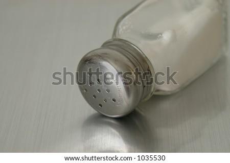 Retro style salt shaker. - stock photo