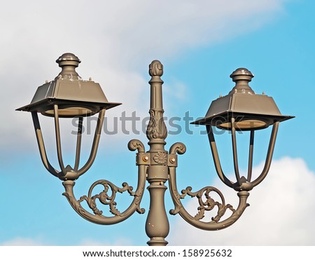 retro style street lamp under clouds