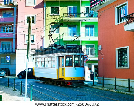 Retro style tram on the street of Lisbon downtown. Portugal - stock photo