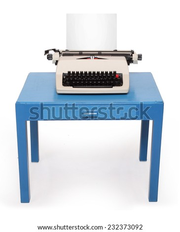 Retro style typewriter with paper on office desk. - stock photo