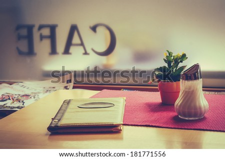 Retro Style VIntage Cafe Table With Menu - stock photo