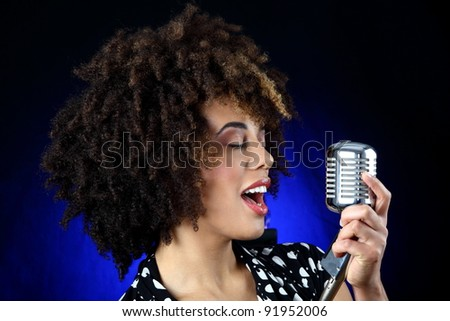 retro style young woman  singing - stock photo
